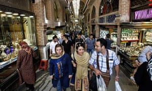 Iranians shop in Tehran's old main bazaar