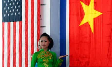Woman in front of Vietnamese flag