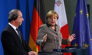 German Chancellor Angela Merkel (R) and Malta's Prime Minister Lawrence Gonzi address the media after talks in Berlin January 9, 2013.
