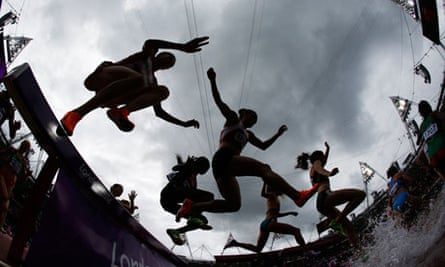 athletes jumping over puddles