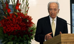 Israeli president Shimon Peres addresses the heads of the Christian denominations in the Holy Land during the traditional reception on new year's eve at the president's residency in Jerusalem on 31 December 2012.