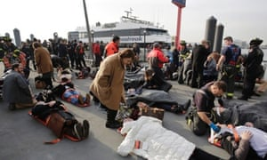 New York ferry crash: at least 50 injured after boat hits