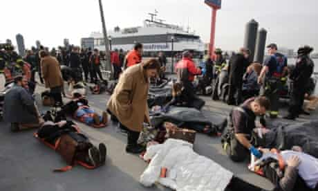 Victims of the Seastreak Wall Street ferry accident are aided by rescue personnel. The ferry from New Jersey made a hard landing at the dock as it pulled up to lower Manhattan.