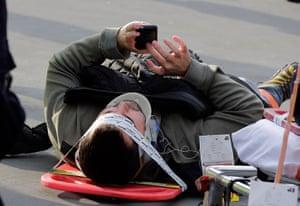 Seastreak ferry: An injured passenger uses his mobile phone