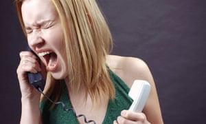 woman screaming down phone