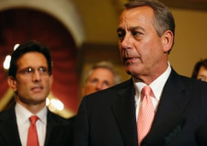 Speaker of the House John Boehner turns away after speaking to the news media with U.S. House Majority Leader Eric Cantor (R-VA) (L) at his side at 1:00 am.