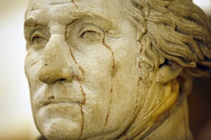 A statue of George Washington, the first president of the United States, is seen near the office of U.S. Speaker of the House John Boehner in the U.S. Capitol building in Washington October 1, 2013.