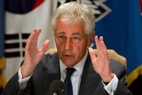 U.S. Secretary of Defense Chuck Hagel speaks to the traveling press about the U.S. government shutdown, at his hotel in Seoul, South Korea, on Tuesday, Oct. 1, 2013.