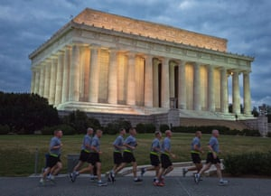 Member of the US military are seen on their morning run in front of the Lincoln Memorial on the National Mall in Washington, DC, on October 1, 2013.