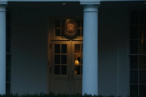 A Uniformed Division Secret Service officer is seen inside the entrance to the West Wing of the White House at dawn in Washington, Tuesday, Oct. 1, 2013.
