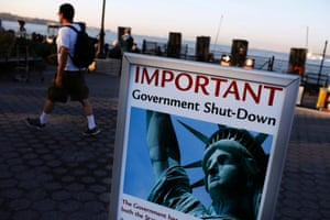 A sign announcing the closure of the Statue of Liberty, due to the U.S. government shutdown, stands near the ferry dock to the Statue of Liberty at Battery Park in New York October 1, 2013