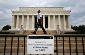 A National Parks policeman walks past a sign after the Lincoln Memorial was sealed off from visitors in Washington, October 1, 2013.