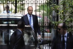 Italy's Interior Minister and national secretary of Berlusconi's party, Angelino Alfano (C) leaves Silvio Berlusconi's private residence, the Palazzo Grazioli, on October 1, 2013 in Rome.