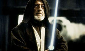 Alec Guinness wields a lightsaber in Star Wars