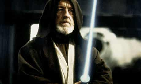 Alec Guinness wields a lightsaber in Star Wars
