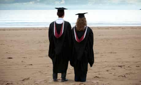 graduates on the beach