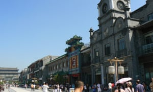 Beijing brandalism … The Rolex store towers above the remade Qianmen shopping street.