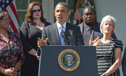 President Barack Obama  speaks in the ROse Garden of the White House alongside citizens who will benefit from the Affordable Care Act.