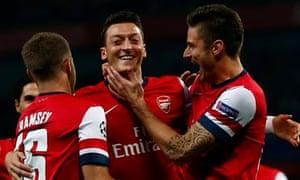 Arsenal's Mesut Özil celebrates with team-mates