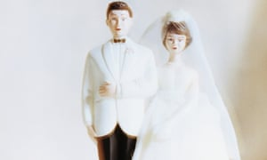 Bride and groom figurines --- Image by   Jason Stang/Corbis Adults Bride Cake Cake decoration Cake topper Clothing Decoration Dress Females Food Formal wear Kitsch Menswear Newlyweds Nobody Old-fashioned Outfit Plastic Retro Still life Suits Sweets Tradition Tuxedo Vintage Wedding Wedding cake Wedding dress White White background Women