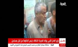 An undated television still that shows what it says is Libyan Prime Minister Ali Zeidan surrounded by men at an unidentified location.