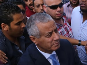 Libyan Prime Minister Ali Zeidan arrives at the government headquarters in Tripoli  shortly after he was freed from the captivity of militiamen who had held him for several hours.