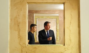 David Cameron talks to trainee Marcus Foster from Bradford in the plastering department during a visit to North Halifax Skills Centre Construction Academy, Halifax, UK.