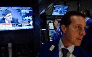 Traders work on the floor of the New York Stock Exchange as US Treasury Secretary Jacob Lew is seen on a screen television, at the start of the trading day in New York, New York, USA, 10 October 2013.
