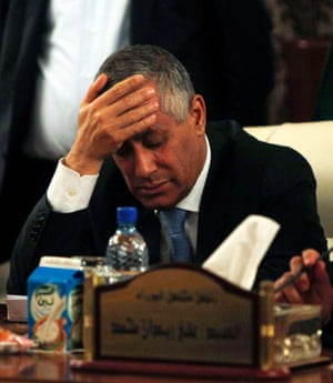 Libya's Prime Minister Ali Zeidan places his hand on his forehead as he addresses a news conference after his release and arrival at the headquarters of the Prime Minister's Office in Tripoli. Zeidan was seized and held for several hours  by former rebel militiamen.