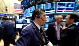 Traders work on the floor of the New York Stock Exchange at the start of the trading day in New York, New York, USA, 10 October 2013.