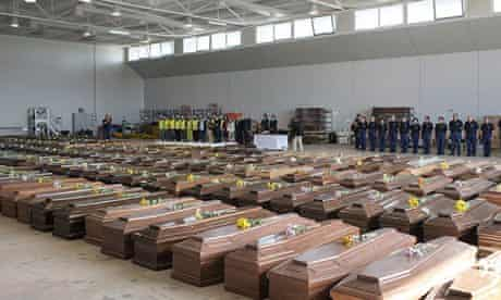 EU delegates pay tribute before rows of coffins containing the bodies of Lampedusa shipwreck victims