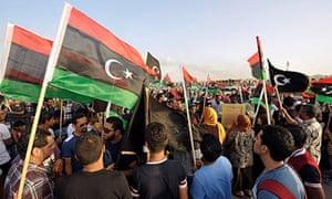 Demonstrators wave Libyan national flags