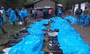 Bodies are lined up for identification after a bus crash in Peru killed 51 people