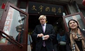 Boris Johnson at a Huton, a traditional Chinese shopping area near Nanluogy Xiang in Beijing.