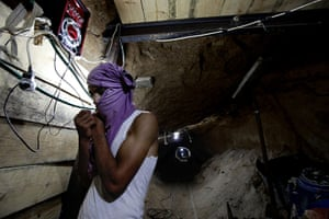 Gaza tunnels: Some mask their faces with shirts to avoid identification while working, fo