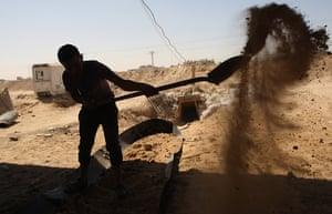 Gaza tunnels: A Palestinian youth works outside a smuggling tunnel