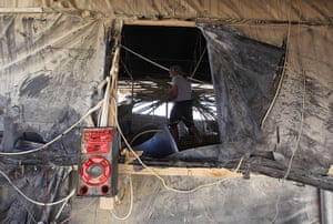 Gaza tunnels: A tunnel worker carries wood as he repairs a tunnel