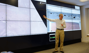 ESA's Jorge Vago stands in front of large video wall