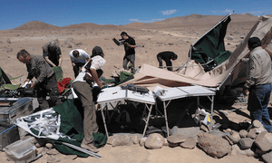 Researchers pick through the wreckage left by the dust devil.