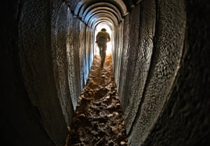 Gaza tunnels: An Israeli soldier walks out from a tunnel during a tour of the tunnel that