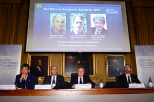 The Royal Swedish Academy of Sciences' Torsten Persson, from left, Per Krusell, Staffan Normark and Per Stromberg announce that Americans Eugene Fama, Lars Peter Hansen and Robert Shiller are the winners of the Nobel prize for economics during a news conference at the Royal Swedish Academy of Sciences in Stockholm, Monday Oct. 14, 2013.