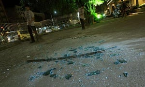 Shattered glass after a bomb went off at the Trader's Hotel in Yangon, Burma