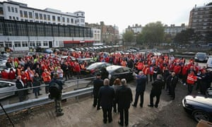 Postal workers attend a rally organised by the Communication Workers Union