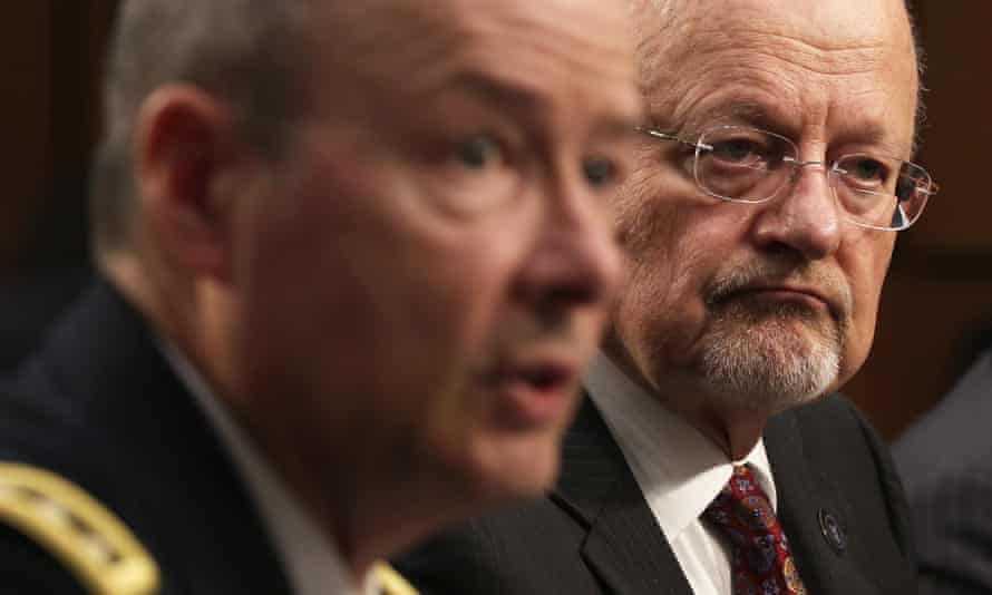 Keith Alexander and James Clapper before a Senate intelligence committee hearing in September.