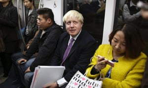 Boris Johnson on a subway train in Beijing.