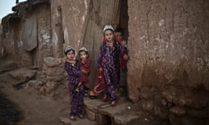 A beautiful photograph of Afghan refugee girls dressed in new clothes to celebrate Eid al-Adha in a poor neighborhood on the outskirts of Islamabad, Pakistan.
