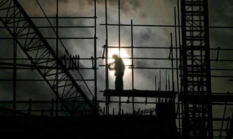 A labourer works on scaffolding at a construction site in Wuhan