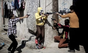 Palestinian children play with plastic weapons during the second day of Eid al-Adha in Gaza City.