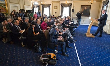 Political journalists take notes as David Cameron speaks