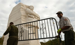 National Park workers remove a barricade at the Martin Luther King Jr. Memorial as it reopens to the pubic in Washington October 17, 2013.